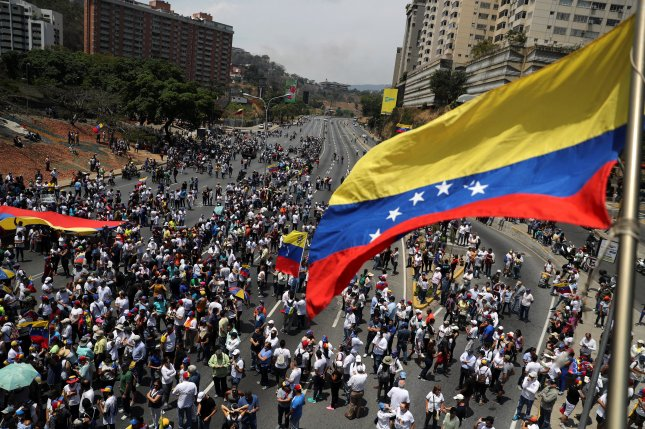 Hundreds of Venezuelan demonstrators rally in the streets of Caracas on May 1 after opposition supporters clashed with government forces. File Photo by Miguel Gutiérrez/EPA-EFE