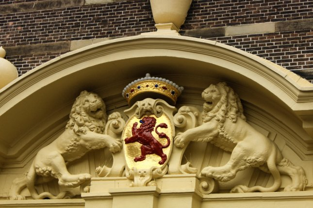 Shell frustrated that Dutch court claims jurisdiction over case of oil spills in the Niger Delta, arguing case should be in the Nigeria justice system. Pictured, the national emblem in The Hague, Netherlands. Photo by miroslav110/Shutterstock