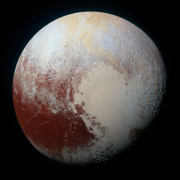 NASA's New Horizons spacecraft captured this high-resolution enhanced color view of Pluto on July 14, 2015. The image combines blue, red and infrared images taken by the Ralph/Multispectral Visual Imaging Camera (MVIC). Pluto's surface sports a remarkable range of subtle colors, enhanced in this view to a rainbow of pale blues, yellows, oranges, and deep reds. Many landforms have their own distinct colors, telling a complex geological and climatological story that scientists have only just begun to decode. Photo by NASA/JHUAPL/SwRI