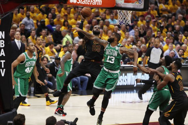LeBron James (C, left) of the Cleveland Cavaliers takes a shot against Marcus Morris (C, right) of the Boston Celtics during the second half of Game 4 of the Eastern Conference finals Monday at Quicken Loans Arena in Cleveland, Ohio. Photo by David Maxwell/EPA-EFE/Shutterstock