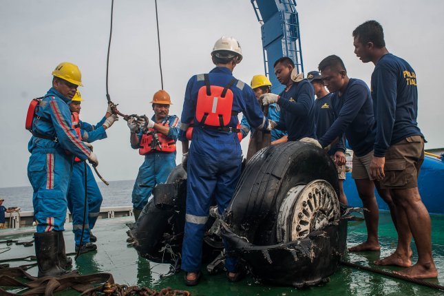 Indonesian rescuers recover the wheels of Lion Air JT-610 on a ship off Karawang, West Java, Indonesia, on November 4. Photo by Fauzy Chaniago/EPA-EFE