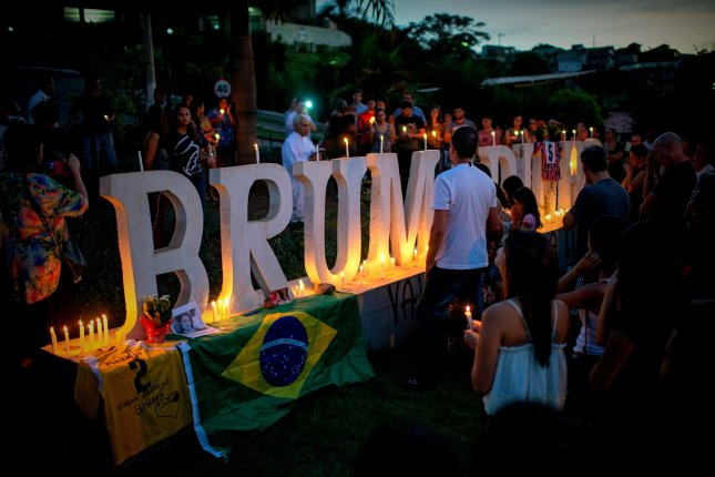 A vigil was held near Belo Horizonte, Brazil, Tuesday as a tribute to the dead and missing from last week's dam collapse. Photo by Lucas Landau/EPA EFE