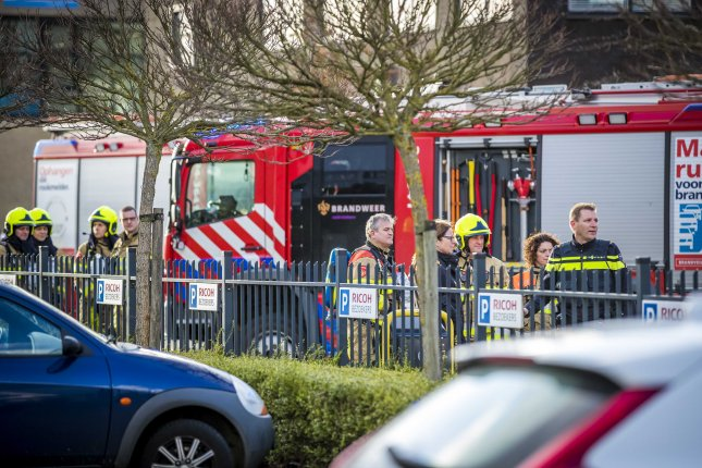 Emergency services gather at a postal sorting company in Kerkrade, the Netherlands, on Wednesday. A bomb letter exploded in the mail room of the company. Photo by Marcel Van Hoorn/EPA-EFE