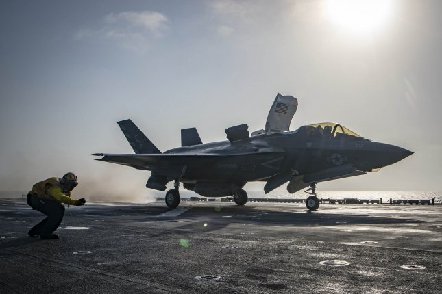 Aviation Boatswain's Mate 1st Class Isaac Berwick launches an F-35B Lightning II aircraft aboard the Wasp-class amphibious assault ship USS Essex as part of the F-35B's first combat strike on Sept. 27, 2018. Photo by Mass Communication Specialist 3rd Class Matthew Freeman/U.S. Navy