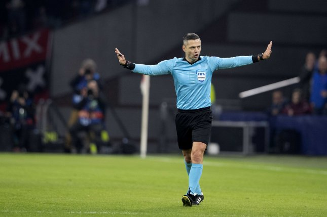 Referee Damir Skomina of Slovenia rejects the goal of Ajax Amsterdam's Nicolas Tafliafico after VAR consultation during the UEFA Champions League round of 16 first leg soccer match between Ajax and Real Madrid on Wednesday in Amsterdam, Netherlands. Photo by Olaf Kraak/EPA-EFE