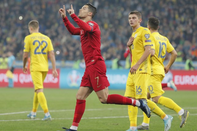 Star striker Cristiano Ronaldo (C) scored in the 72nd minute of a 2-1 loss to Ukraine Monday in Kiev, Ukraine. Photo by Sergey Dolzhenko/EPA-EFE