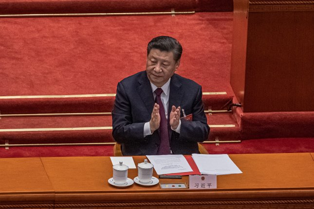 Chinese President Xi Jinping claps after voting on a proposal to draft changes of election rules for Hong Kong during the closing session of the National People's Congress, at the Great Hall of the People, in Beijing, China, on Thursday. Photo by Roman Pilipey/EPA-EFE
