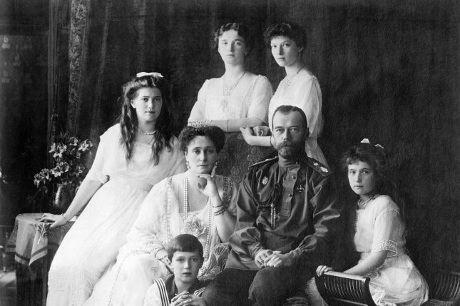 On July 17, 1918, Russian Czar Nicholas II (seated, 2nd-R) and his family were killed by Bolsheviks who had held them captive for two months. Seated, from left are Marie, Queen Alexandra, the czar and Anastasia, behind Alexei in front. In back are Olga (L) and Tatiana. File Photo courtesy the Library of Congress