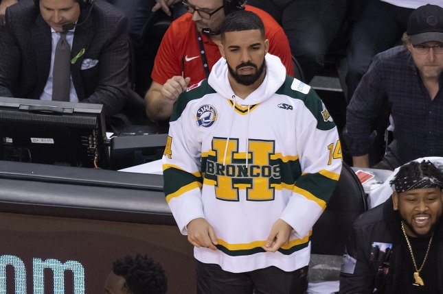 Canadian musician Drake (top) wears a Humboldt Broncos hockey jersey while watching the NBA Eastern Conference First Round basketball playoff game between the Washington Wizards at Toronto Raptors on April 14 at the Air Canada Centre in Toronto, Canada. Photo by Warren Toda/EPA-EFE/Shutterstock