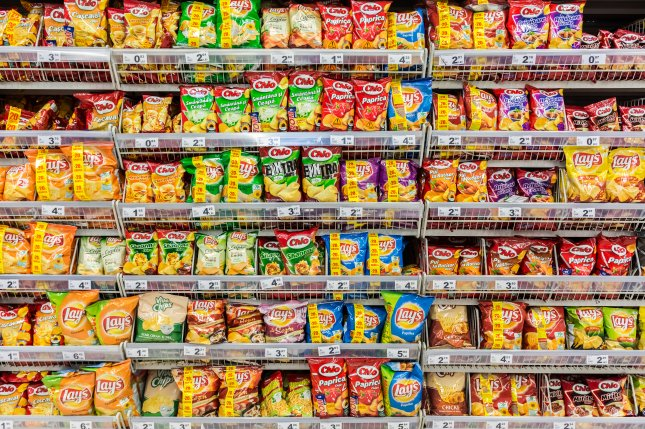 The larger the quantities and wider the arrays of snack food options snack for kids, the more likely they are to overeat. File Photo by Radu Bercan/Shutterstock