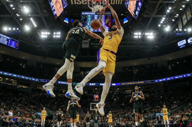 Los Angeles Lakers forward Anthony Davis (R) scored a game-high 36 points, while Milwaukee Bucks star Giannis Antetokounmpo (L) scored 34 points Thursday at Staples Center in Los Angeles. Photo by Tannen Maury/EPA-EFE