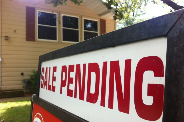 Image of a house with a sale pending sign. A new report released Wednesday said that mortgage applications to purchase a home were up 5 percent from last wee. Photo by Dan Moyle/Flickr