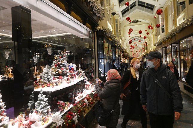Customers shop Saturday at Burlington Arcade in London after British Prime Minister Boris Johnson delivered a televised statement announcing more restrictions. Photo by Facundo Arrizabalaga/EPA-EFE