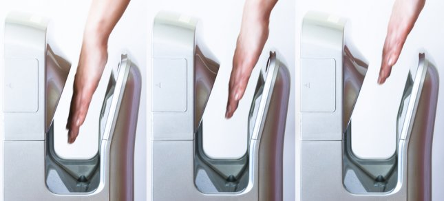 Researchers found in a recent study that jet dryers in bathrooms, such as the Dyson Airblade, spread far more germs than traditional hand dryers or paper towels. Photo by Tiramisu Studio/Shutterstock