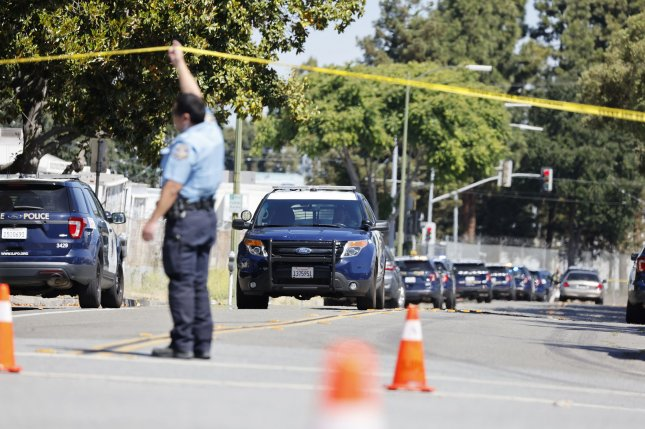 Police and investigators are seen Wednesday at the site of a shooting at the San Jose Valley Transportation Authority light rail yard in San Jose, Calif. Nine people were killed. Photo by John G. Mabanglo/EPA-EFE