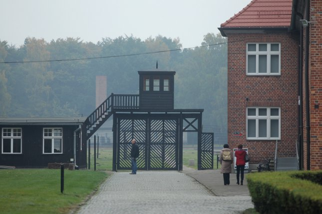 A group of Holocaust survivor organizations want the Polish government to investigate how a group of artists gained access to the gas chamber at the Stutthof concentration camp in Poland in 2015. File Photo by Piotr Wittman/EPA