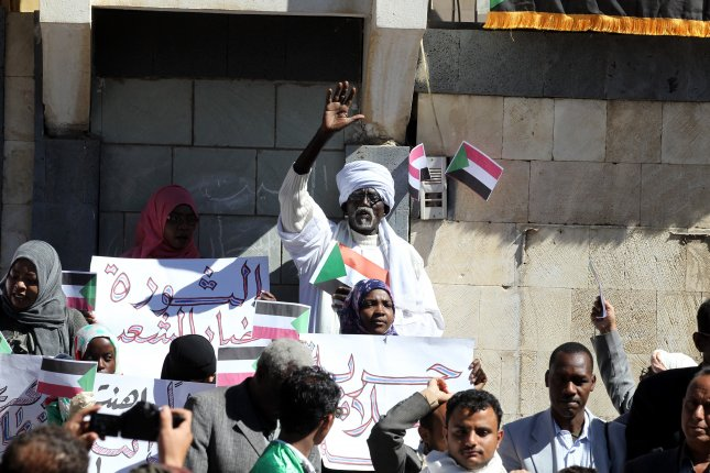Sudanese protesters take part in a rally against the Sudanese government of President Omar al-Bashir. The death toll in the monthlong protests rose to at least 29 people on Thursday. Photo by Yahya Arhab/EPA