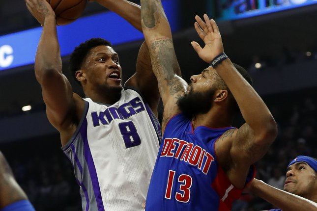 Sacramento Kings forward Rudy Gay (L) goes to the basket as Detroit Pistons forward Marcus Morris (C) and Detroit Pistons forward Tobias Harris (R) defend on January 10 at the Golden 1 Center in Sacramento, Calif. Photo by John G. Mabanglo/EPA
