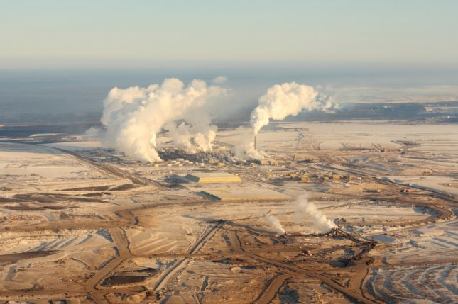 A trade group says Canada can be a supplier of choice with the right government support. Pictured, oil sands development in northern Alberta, Canada. File photo by Chris Kolaczan/Shutterstock
