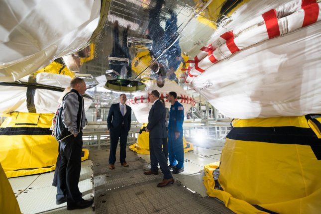 NASA Administrator Jim Bridenstine (C) gets a tour of the B-2 Test Stand on a work platform between the four RS-25 engines of the first core stage of the agency's Space Launch System rocket at the Stennis Space Center near Bay St. Louis early lat year. File Photo by Joel Kowsky/NASA