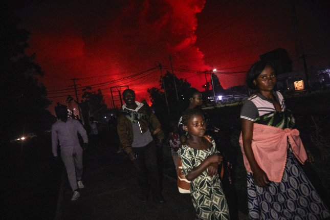Congolese residents of Goma flee from Mount Nyiragongo volcano as it erupts over Goma, Democratic Republic of the Congo, on May 22. Photo by Hugh Kinsella Cunningham/EPA-EFE