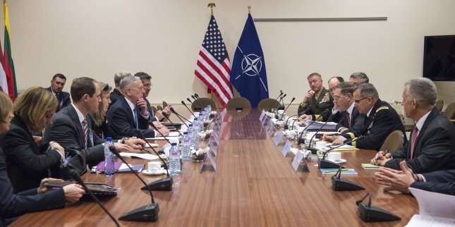 Secretary of Defense James Mattis meets with members of the U.S. mission at the NATO Headquarters in Brussels, Belgium on Wednesday. Mattis urged NATO allies to pay for their share of defense spending. Photo by U.S. Air Force Tech. Sgt. Brigitte N. Brantley/Department of Defense