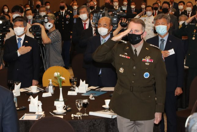 South Korean Defense Minister Jeong Kyeong-Doo (L) and U.S. Forces Korea commander Gen. Robert Abrams (R, front), salute their national flags at the sixth Korea-U.S. alliance forum at the defense ministry's convention center in Seoul on Wednesday. Photo by Yonhap/EPA-EFE