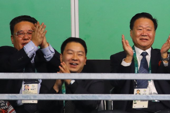Choe Ryong-hae (R), vice chairman of North Korea's State Affairs Commission, applauds with North Korean officials while watching the women's singles table tennis game between the North's Kim Song-i and Taiwan's Chen Szu-yu at the Rio 2016 Summer Olympic Games on August 8. Choe has busied himself with attending matches at the Rio Olympic Games, but may not have met with the Brazilian president, contrary to North Korea's statements. Photo by Yonhap News Agency/UPI