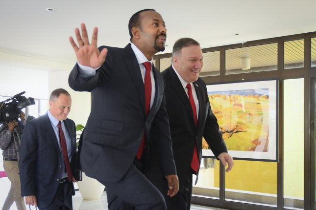 U.S. Secretary of State Mike Pompeo (R) and Prime Minister of Ethiopia Abiy Ahmed walk Tuesday at the premier's office in Addis Ababa, Ethiopia. Photo by EPA-EFE