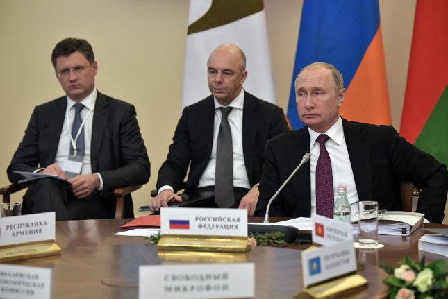 Russian President Vladimir Putin (R), Finance Minister Anton Siluanov (C) and Energy Minister Alexander Novak (L) attend a meeting of the Eurasian Economic Union in St.Petersburg, Russia, to discuss issues including energy on Dec. 6, the same day OPEC countries met in Vienna. Photo by Alexey Nikolsky/EPA-EFE/Kremlin pool mandatory credit