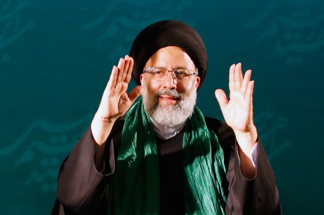 Ebrahim Raisi greets the crowd during an election rally in Tehran in 2017. He is again running for president of Iran. File Photo by Abedin Taherkenareh/EPA-EFE