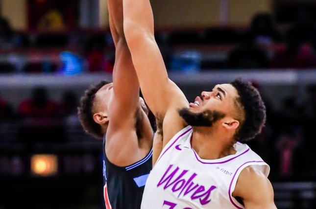 Minnesota Timberwolves center Karl-Anthony Towns scored 27 points, including a huge first half slam, in a loss to the Orlando Magic on Thursday in Orlando. Photo by Tannen Maury/EPA-EFE