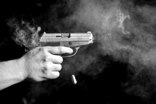 A police officer accidentally discharged his weapon while practicing his quick draw skills in a Des Moines, Iowa, International Airport office Wednesday. File photo by csabacz/Shutterstock