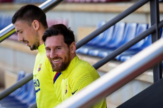 Lionel Messi (R) and FC Barcelona returned to training on May 8 and will likely resume their La Liga schedule in mid-June. Photo by Enric Fontcuberta/EPA-EFE