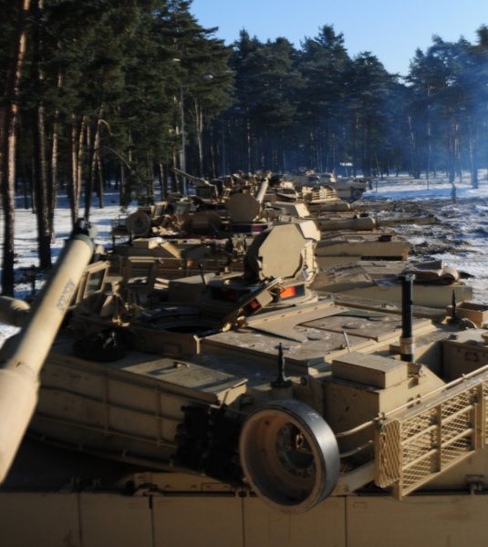 M1A2 Abrams Tanks belonging to 1st Battalion, 68th Armored Regiment, 3rd Armored Brigade, 4th Infantry Division sit in a motor pool in Trzebien, Poland on Wednesday after arriving from Fort Carson, Colo. They will be used by the soldiers as they conduct training in Eastern Europe as part of Operation Atlantic Resolve. Photo by Staff Sgt. Corinna Baltos/U.S. Army