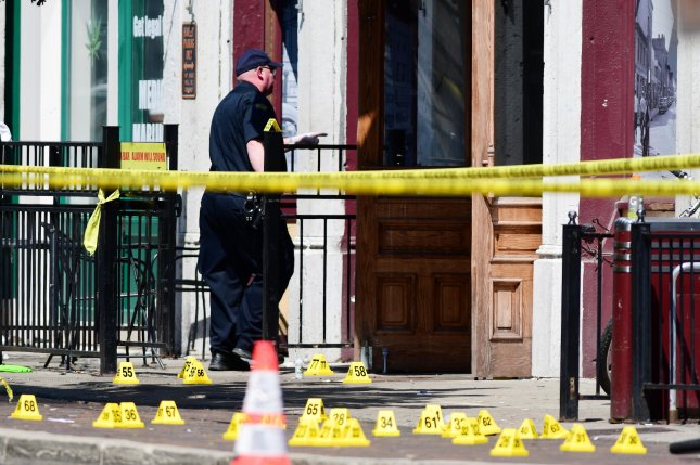 Evidence markers of shell casings line the street at the scene of a shooting in the Oregon District of Dayton, Ohio, early Sunday. Photo by Tom Russo/EPA