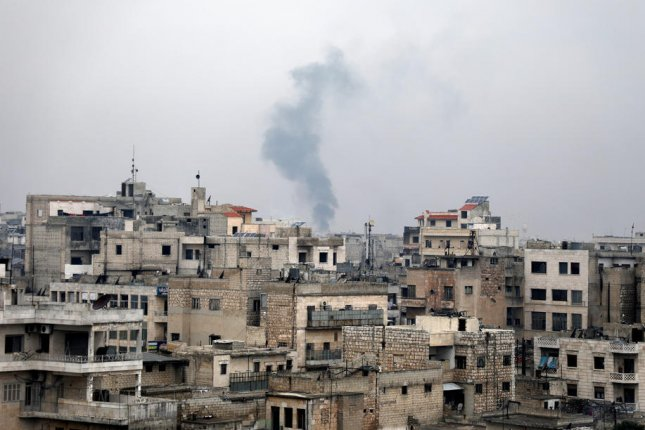 Smoke rises during a Syrian government bombing in the village of Sarmin, near Idlib in February. Two watchdog groups said fewer civilians died in March than any other time during the country's civil war, which started in 2011. Photo by Yahya Nemah/EPA-EFE
