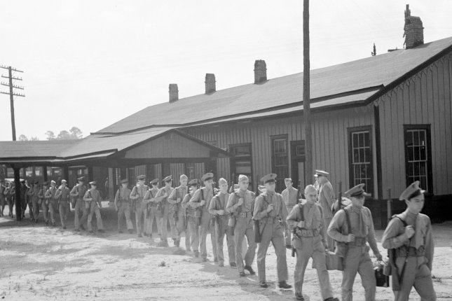 U.S. Marine Corps recruits, part of the glider detachment training group, make their way to the Parris Island Recruit Depot, May 1942. File Photo by Library of Congress/UPI