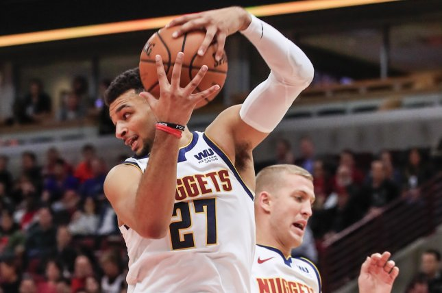 Denver Nuggets guard Jamal Murray of Canada (L) pulls down a rebound next  to Denver Nuggets forward Mason Plumlee (R) during their NBA game against  the ... 81a00e619
