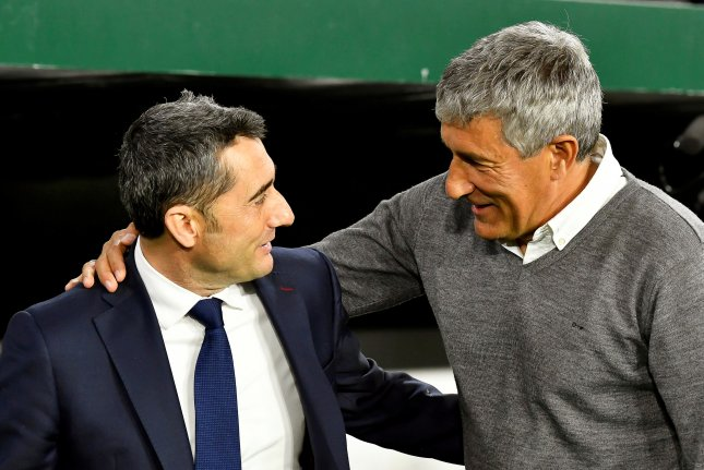 Quique Setien (R) will coach Barcelona in a La Liga match against Granada Sunday in Barcelona after the club fired manager Ernesto Valverde (L). Photo by Raul Caro/EPA-EFE