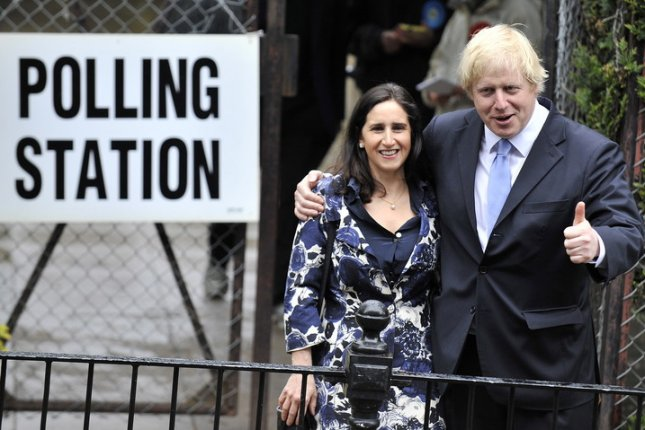 British Prime Minister Boris Johnson (right) and wife Marina Wheeler, seen here in 2012, have reached a financial settlement in their divorce proceedings. File photo by Andy Rain/EPA-EFE