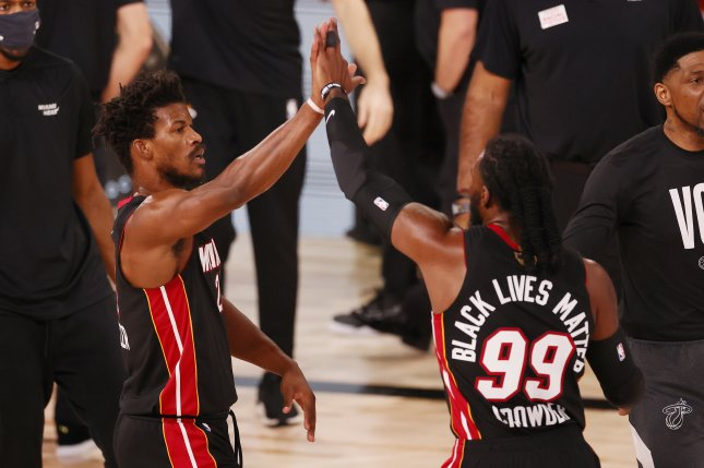 Miami Heat forward Jimmy Butler (L) and teammate Jae Crowder celebrate in the first quarter of Game 3 of the NBA Finals on Sunday at the ESPN Wide World of Sports Complex near Orlando, Fla. Photo by Erik S. Lesser/EPA-EFE