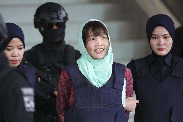 Vietnamese Doan Thi Huong smiles as she is escorted Monday by Malaysian police at the Shah Alam High Court in Shah Alam, Malaysia. Photo by Fazry Ismail/EPA-EFE