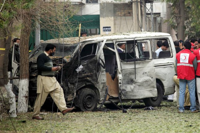 Pakistani security officials inspect the scene of a suicide bomb attack Wednesday that targeted a van transporting the staff and judges in Peshawar, Pakistan. The driver died and four judges were injured in the blast. Photo by Arshad Arbab/EPA