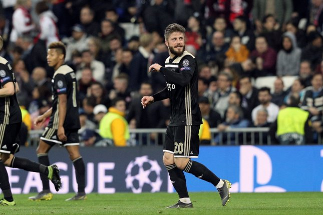 3ff389af7 Ajax's Lasse Schone netted a beautiful bent free kick for the final goal of  a UEFA Champions League round of 16 second leg match between Real Madrid  and ...
