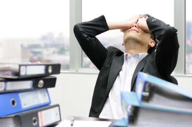 New research in Germany suggests the combination of high blood pressure, poor sleep habits and a stressful job significantly increases risk for death from heart disease. File Photo by Tigger11th/Shutterstock