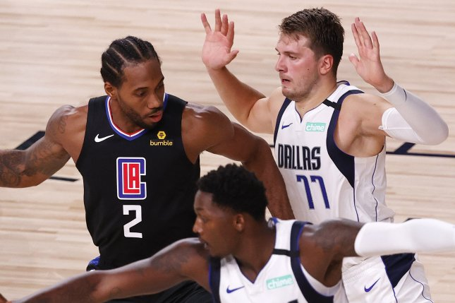 Los Angeles Clippers forward Kawhi Leonard (2) scored 29 points and Dallas Mavericks guard Luka Doncic (77) scored a game-high 42 points in Game 1 of a Western Conference playoff series Monday at the ESPN Wide World of Sports Complex in Orlando, Fla. Photo by John G. Mabanglo/EPA-EFE