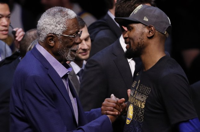 NBA Hall of Fame legendary former player Bill Russell (L) shakes hands with NBA MVP Golden State Warriors Kevin Durant (R) after defeating the Cleveland Cavaliers to win the NBA Finals in Game 4 on June 8 at Quicken Loans Arena in Cleveland. Photo by David Maxwell/EPA-EFE