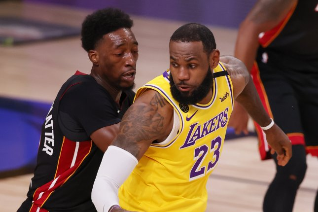 Los Angeles Lakers forward LeBron James (R) is guarded by Miami Heat forward Bam Adebayo (L) in the first half of Game 1 of the NBA Finals on Sept. 30, 2020, at the ESPN Wide World of Sports Complex near Orlando, Fla. File Photo by Erik S. Lesser/EPA-EFE