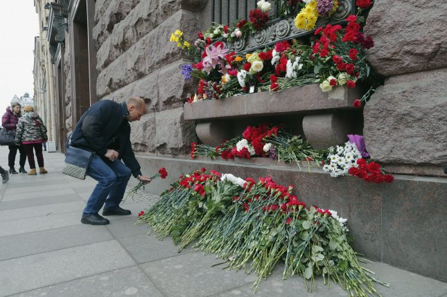 A man lays flowers outside Tekhnologicheskiy Institute subway station to pay tribute for the victims of a bombing in St. Petersburg subway system in Russia on Tuesday. The explosion resulted in the deaths of at least 14 people and injury to dozens of others. Russian officials have identified Akbarjon Djalilov, a Kyrgyz-born Russian citizen, as the attacker. Russia has begun a three-day mourning period. Photo by Anatoly Maltsev/EPA